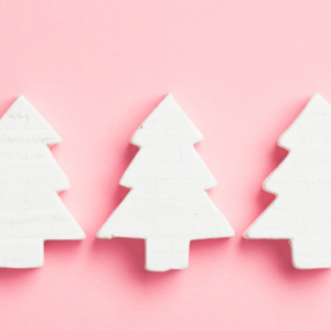 white christmas tree shapes pink background