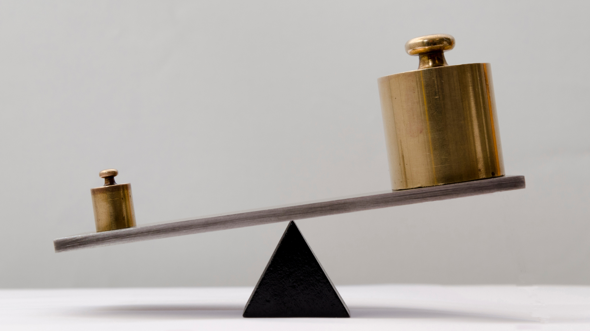 seesaw scales where smaller weight is heavier