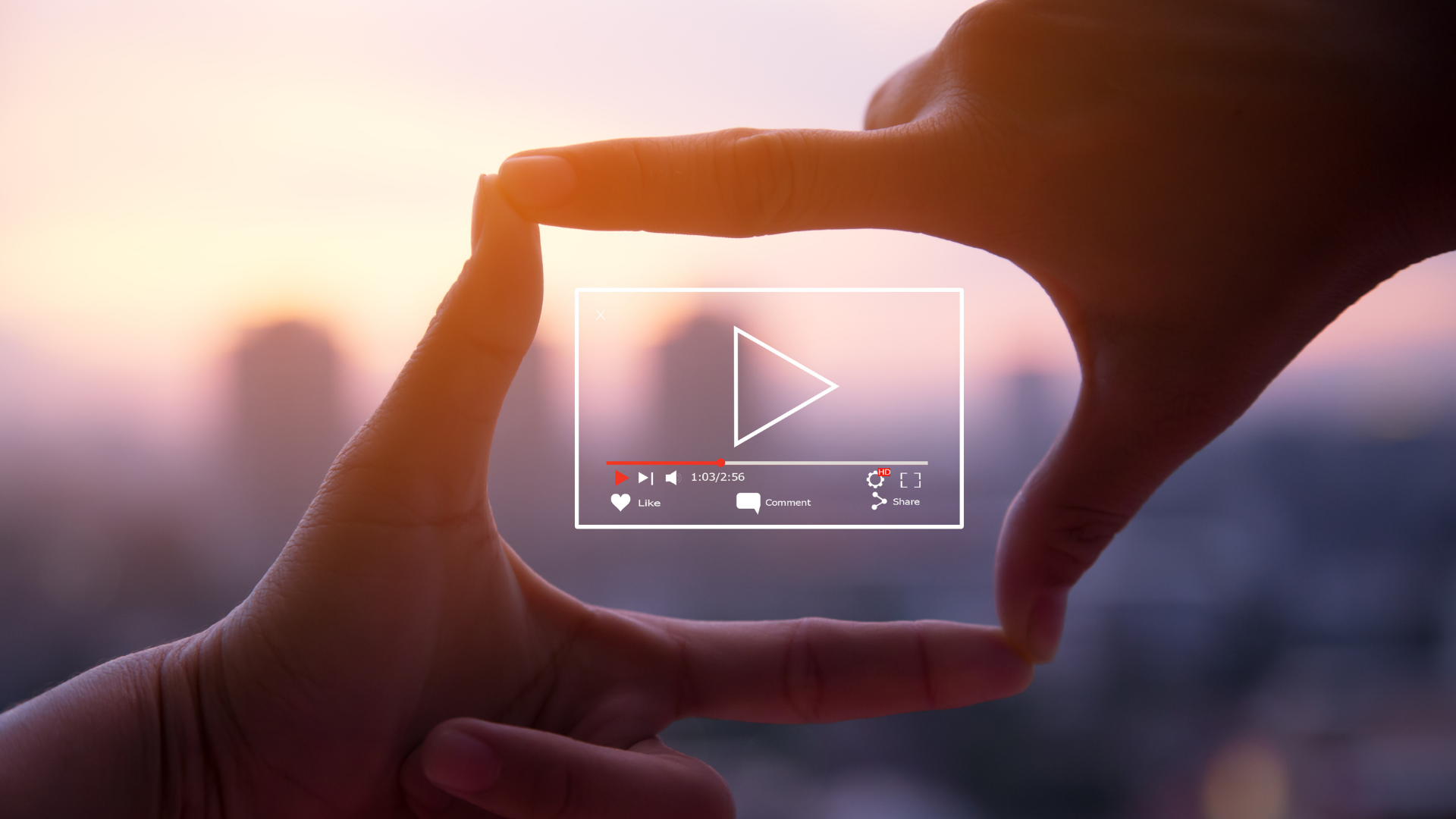 Hands surrounding drawing of play button in video