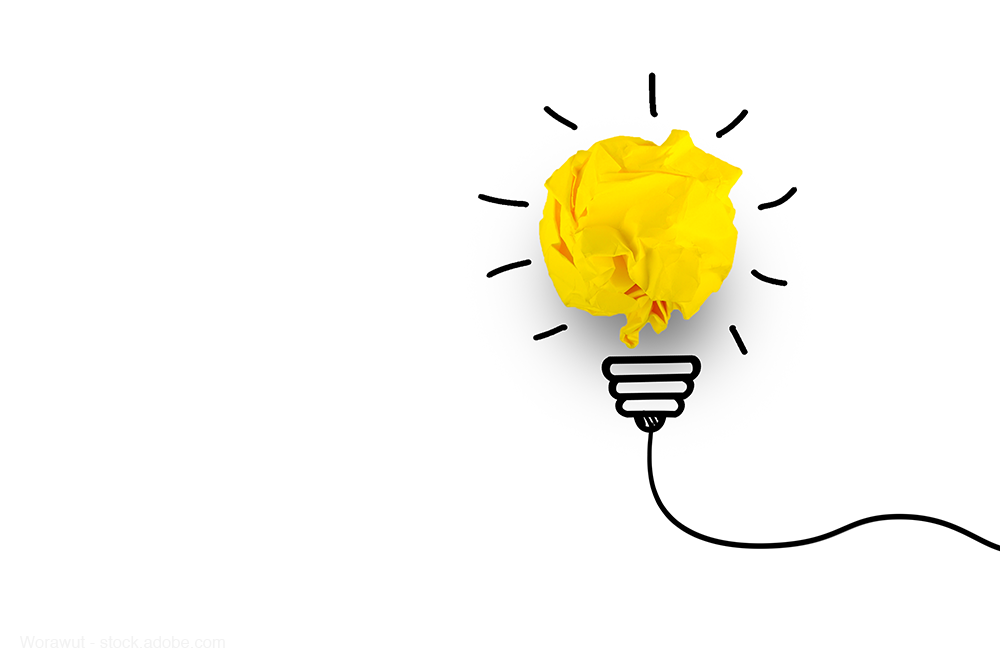 drawing of light bulb with scrunched up yellow paper as light