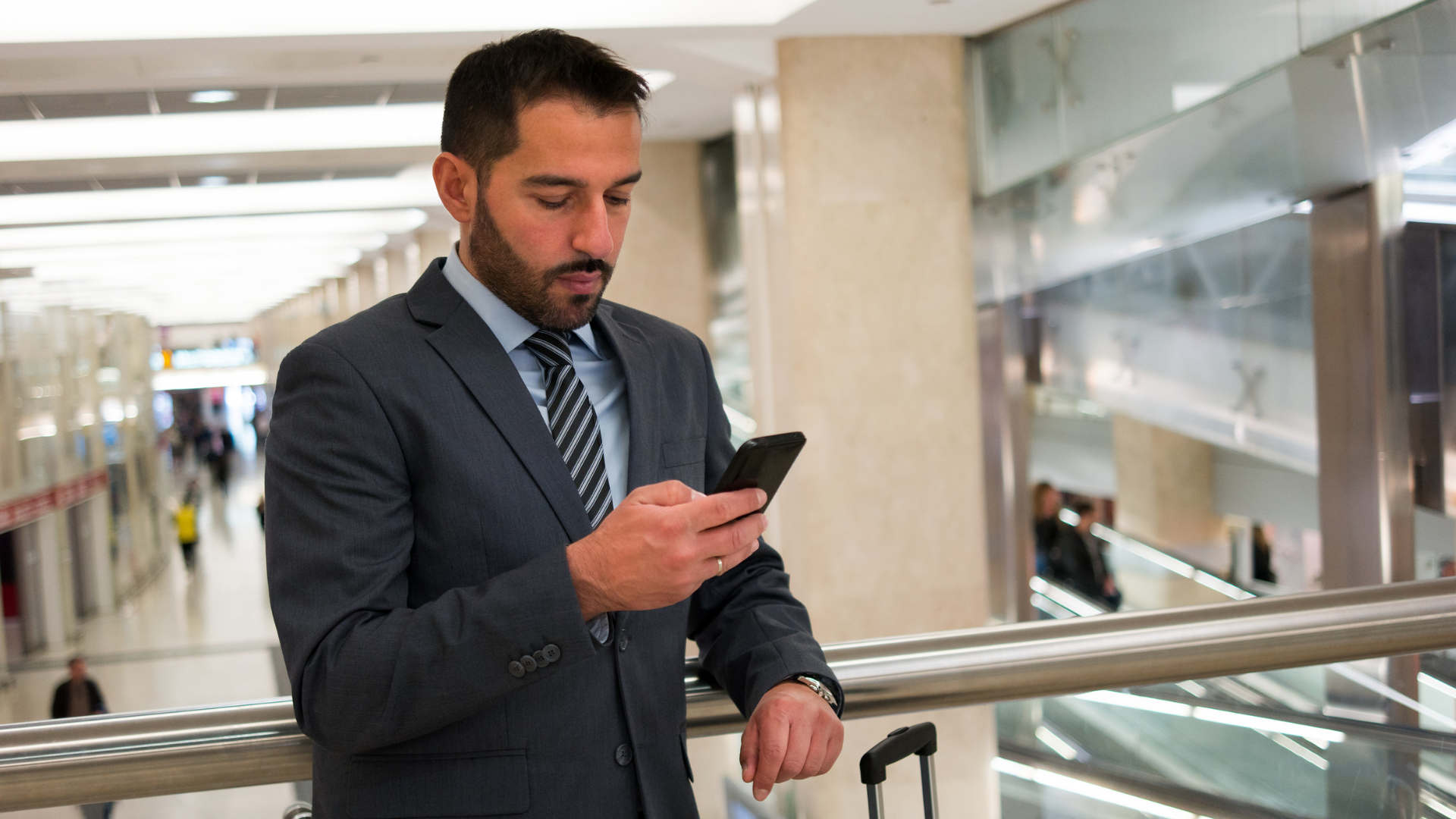 Business man texting on mobile phone