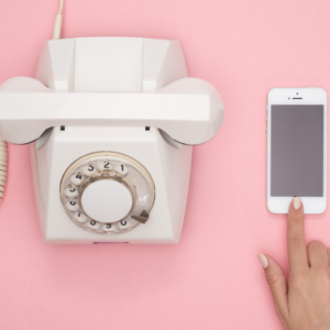 Old-fashioned-phone-next-to-iphone