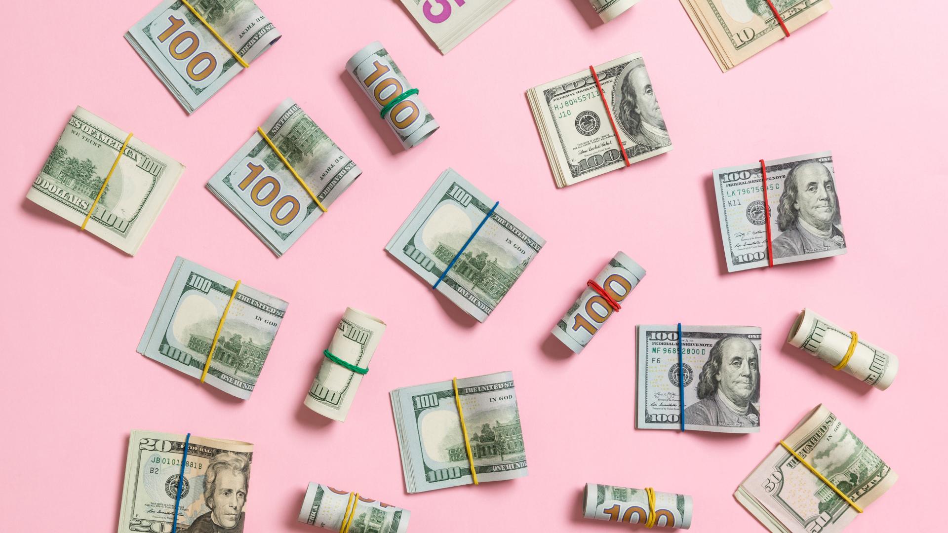dollar bills on pink background