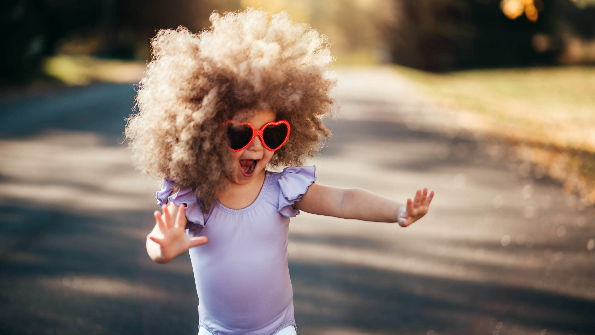 little-girl-wearing-wig-and-sunglasses