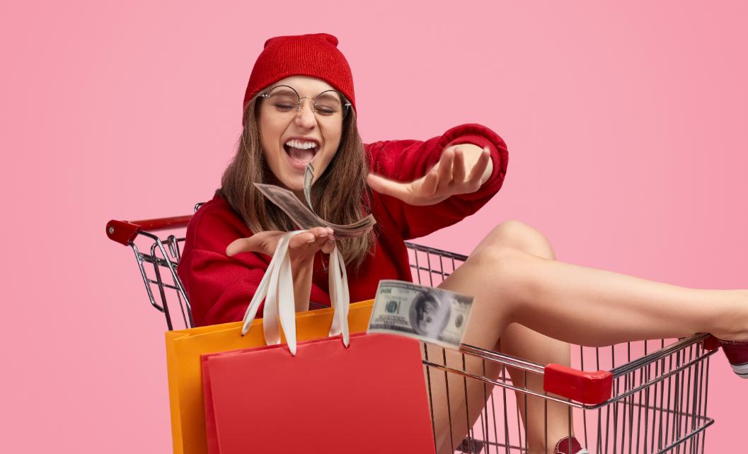 woman-in-shopping-basket-throwing-money
