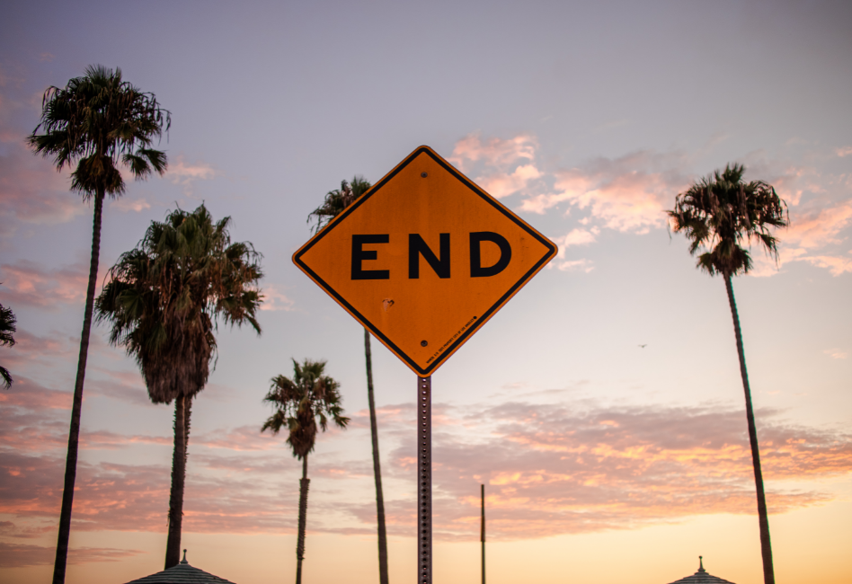end-sign-palm-trees