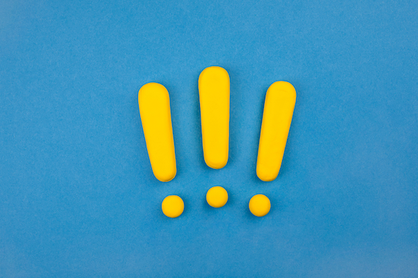 Three,Vivid,Exclamation,Marks,On,Blue,Background.,Keep,Attention,Concept,